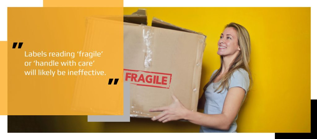 Woman holding box labelled fragile