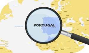 European map Portugal highlighted by magnifying glass