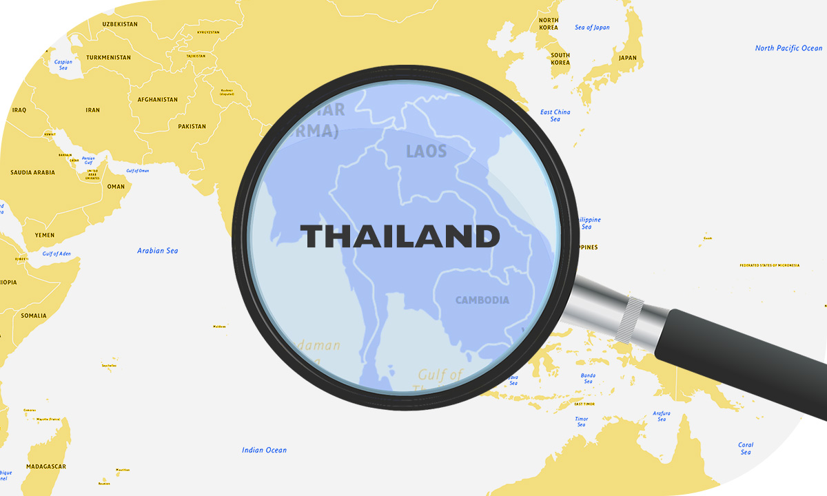 Map of Asia with Thailand highlighted by magnifying glass